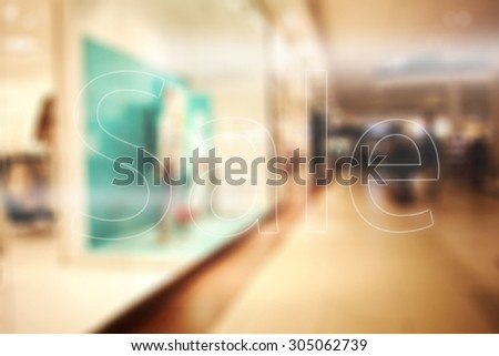sale text on shop glass  - stock photo