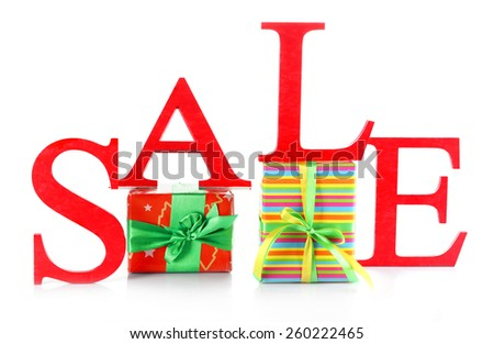 Sale with gifts isolated on white - stock photo