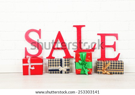 Sale with gifts on floor in room - stock photo