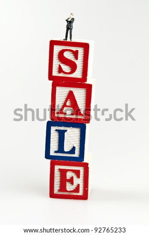 Sale word and toy business man - stock photo