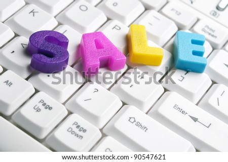 Sale word made by colorful letters on keyboard