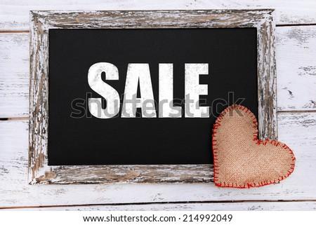 Sale writing on blackboard, close-up - stock photo