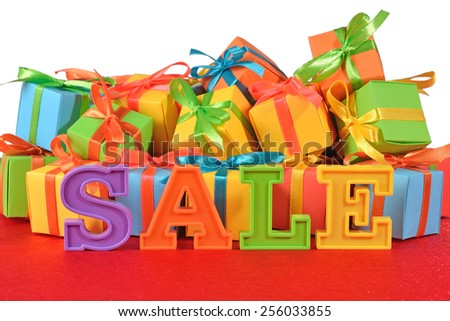 Sale written by colorful letters on the background of varicolored gifts - stock photo