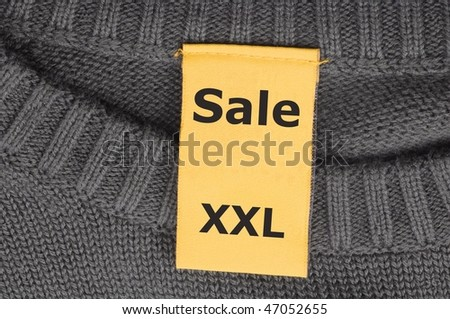 sale xxl on fashion label showing clothes discount concept