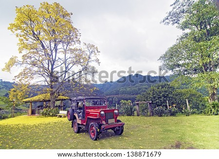 SALENTO, COLOMBIA - JUNE 16: Vintage Jeep Willys in the mountains ready to cross the Coffee Triangle, on June 16, 2012 in Salento, Colombia.  These Jeeps are widely used across the coffee plantations.