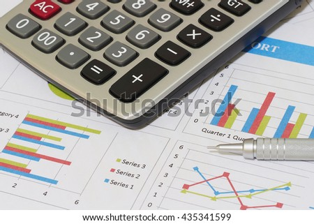 Sales and financial business report, pencil and calculator