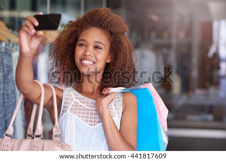 Sales and selfies at the shopping mall - stock photo