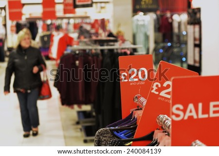 Sales at Clothes Store Background - Image Has a Shallow Depth of Field - stock photo