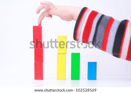 sales charts symbolized by wood toys............ - stock photo