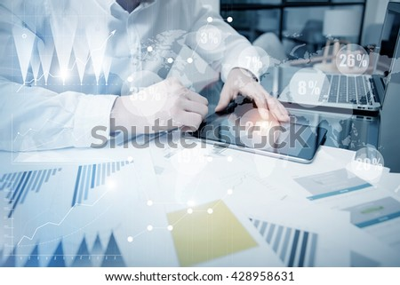 Sales Department Work Online Process.Photo Trader working Market Report Documents Touching Screen Tablet.Using Graphics,Stock Exchanges Reports,Digital Interfaces.Business Project Startup.Horizontal - stock photo