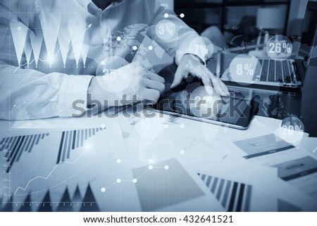 Sales Department Work Online Process.Photo Trader working Market Report Documents Touching Screen Tablet.Using Graphics,Stock Exchanges Reports,Digital Interfaces.Business Project Startup.Black White - stock photo