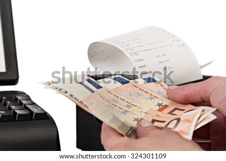 Sales man holding cash in payment for purchases in the store. Close up. Receipt Printer with paper shopping bill . Point of Sale System, isolated on white background. - stock photo