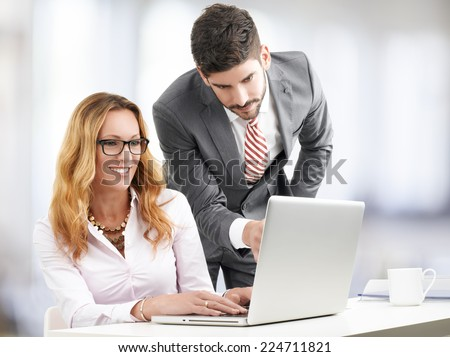 Sales man presenting his idea to colleague. Business people.  - stock photo