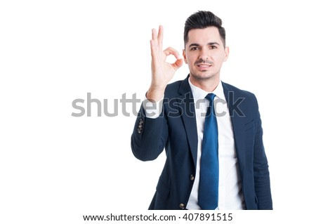 Sales man showing perfect or excellent gesture isolated on white background - stock photo