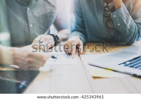 Sales Managers Team Brainstorming Process in modern office.Project Producers use Digital Gadgets,analyze reports.Young Business crew working New Startup studio.Blurred,film effect - stock photo