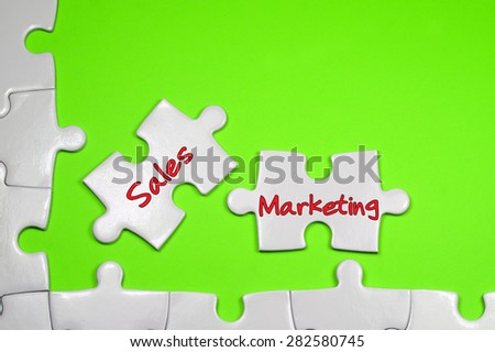 Sales Marketing word on white puzzle - Business Concept - stock photo