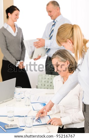 Sales meeting business people review reports consulting new strategy - stock photo