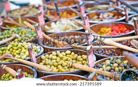 Sales of traditional products -Mediterranan olives- in the market - stock photo