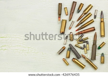 Sales of weapons and ammunition. Trade in arms and ammunition. Different types of ammunition. Bullets of different calibers and types. The right to own a gun - stock photo