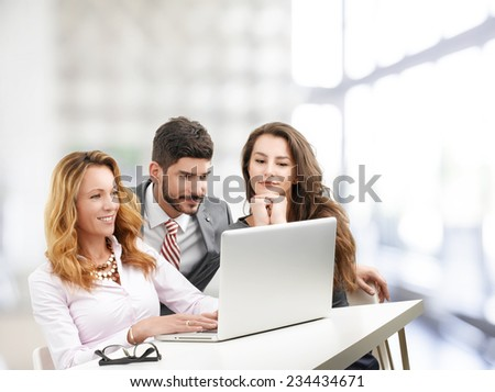 Sales people working on laptop while sitting at meeting in office. Teamwork.  - stock photo