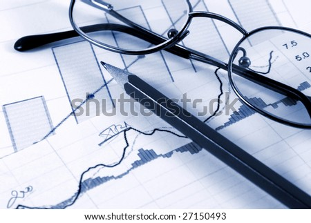 Sales report concept; diagrams,pen and glasses