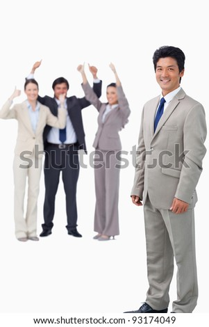 Salesman getting celebrated by his team against a white background - stock photo