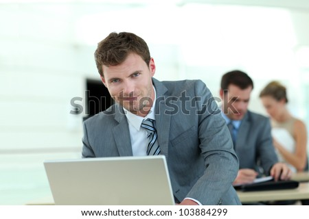 Salesman in grey suit attending business training - stock photo