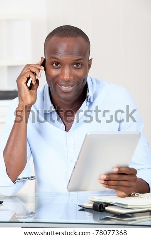 Salesman in office talking on the phone - stock photo