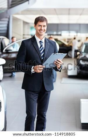 Salesman in the showroom - stock photo