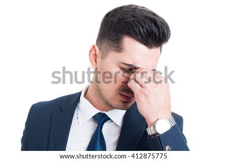 Salesman or broker having a headache and stress migraine concept isolated on white background - stock photo