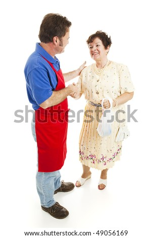 Salesman shakes hands with a happy customer.  Isolated on white. - stock photo