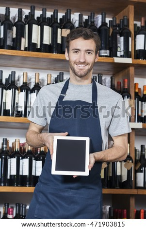 Salesman Showing Blank Digital Tablet In Wine Shop