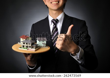 Salesman suit that has a model of the house