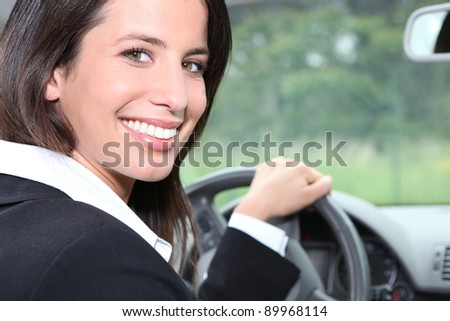 Salesperson driving a car - stock photo