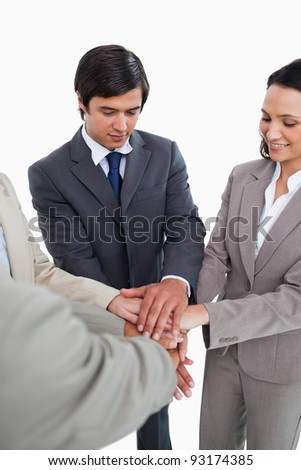 Salesteam motivating each other against a white background