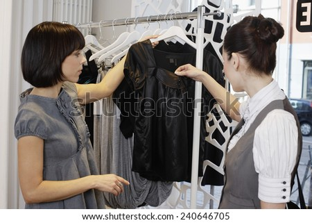 Saleswoman and Customer in Boutique - stock photo