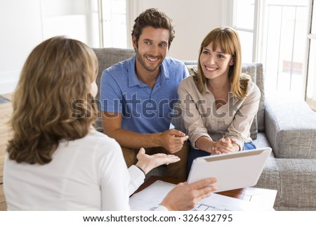 Saleswoman presenting a new project property on digital tablet - stock photo