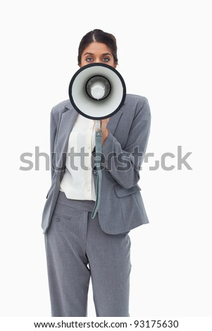Saleswoman using megaphone against a white background
