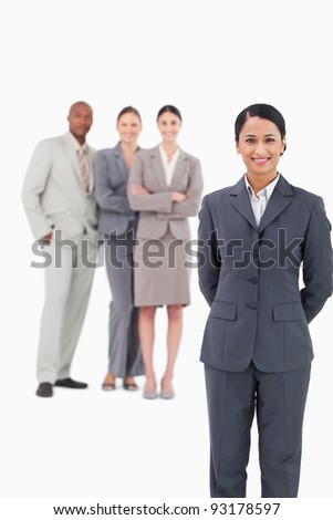 Saleswoman with her team behind her against a white background