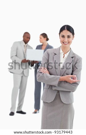 Saleswoman with talking colleagues behind her against a white background