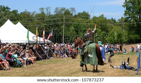 SALINE, MI - JULY 14: Unidentified victorious jouster acknowledges crowd at the Saline Celtic Festival July 14, 2012 in Saline, MI.