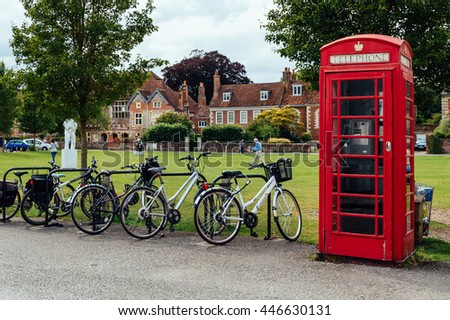 Salisbury, UK - August 16, 2015: Red telephone box and bicycles in a beautiful park. Salisbury is a cathedral city in Wiltshire, England.