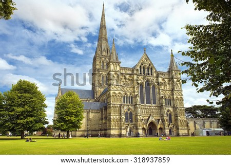 SALISBURY, UNITED KINGDOM -  August 03, 2015: Salisbury Cathedral and park on sunny day on August 03, 2015 in Salisbury, South England - stock photo