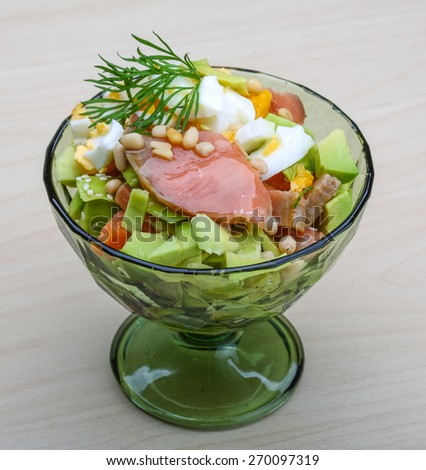 Salmon and avocado salad with dill and sesame seeds - stock photo