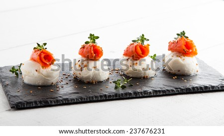 Salmon and cheese appetizer on a slate board  - stock photo