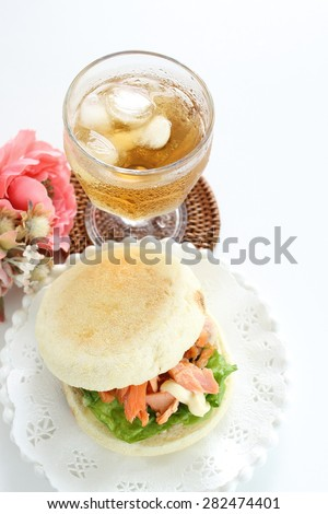 Salmon and English muffin Sandwich with iced tea - stock photo