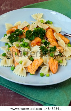 Salmon and pea pasta on plate - stock photo