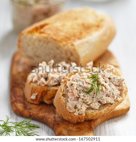 Salmon and soft cheese spread on bread - stock photo