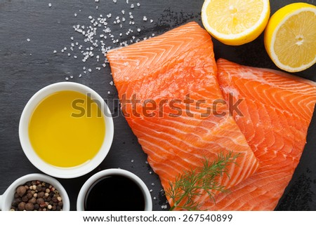 Salmon and spices on stone table. Top view - stock photo