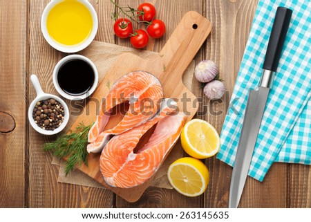 Salmon and spices on wooden table. Top view - stock photo